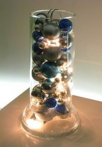 Baubles lit up in a tall vase
