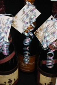 Curled ribbon on the bottles of bubbly