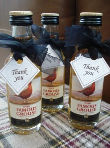 Miniature whiskeys for the Gents decorated with black ribbon & thankyou tag