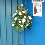 Pedestal floral arrangement to welcome guests to Golden Wedding Anniversary celebration