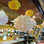Pom poms were hung from the bar with laminated photos of the celebrating couple