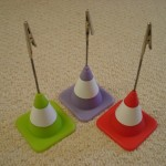 Quirky traffic cone place card holders which double up as photo display favours